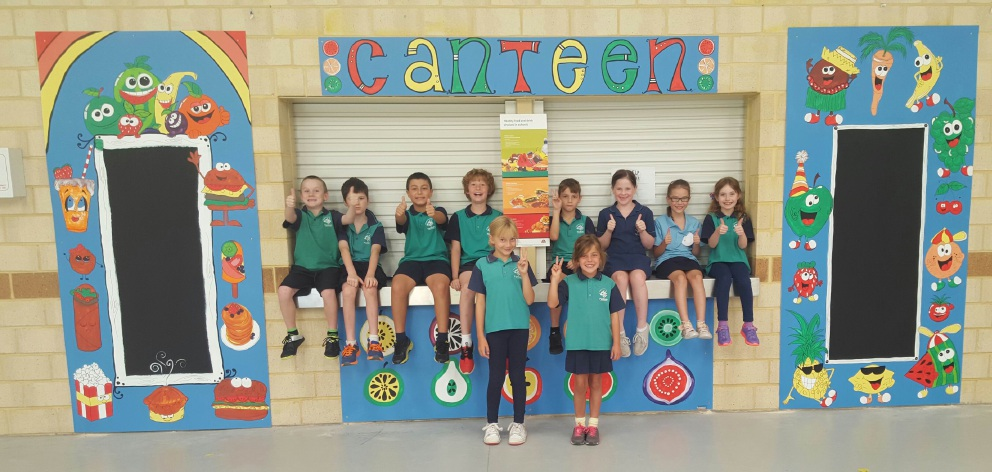 Year 3 students give the thumbs-up to the new-look canteen at Padbury Primary School.