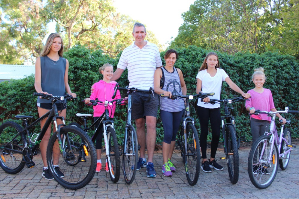Sloan, Summer, Matt, Julie, Mia and Tenley Burton prepare for the Freeway Bike Hike on April 3.