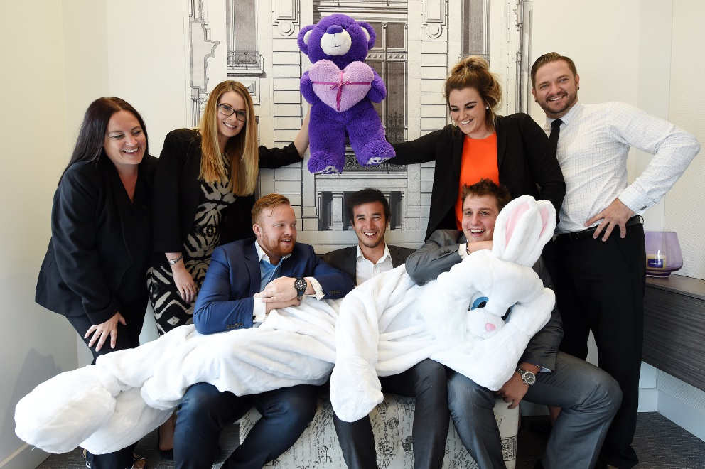 Employees of Coulson   & Co Real Estate getting into the right mindset – and costume – for the company's Easter egg hunt.