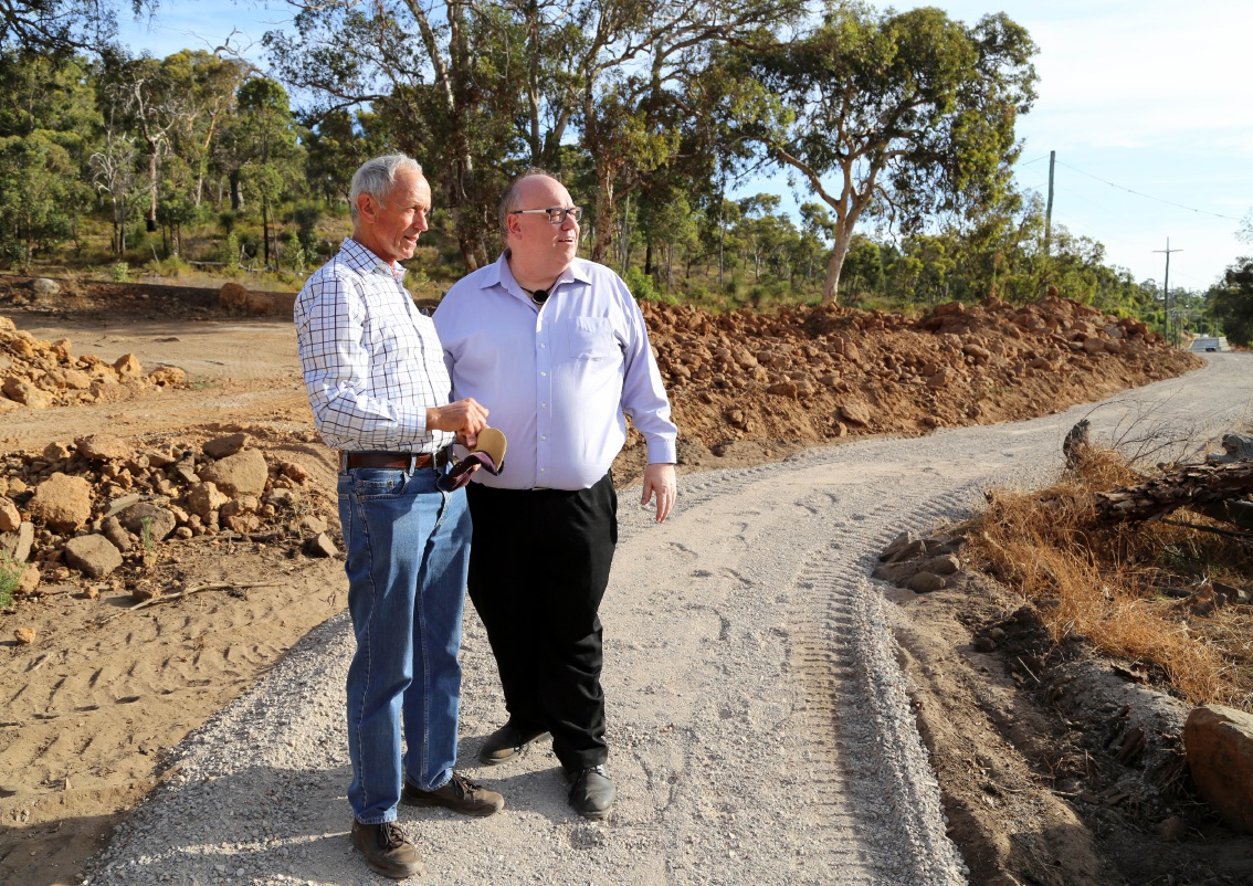 Mike Robinson and Shire president Andrew Waddell survey the cleared path at the site.