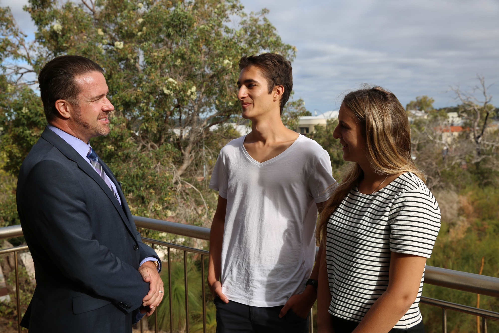 Joondalup Mayor Troy Pickard chats to volunteers Baptiste Riches and Megan Walton.