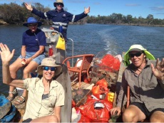 Madou Ependa, Denise Shelbourne, Marcus McGregor and Gary Phillips clean up the river.