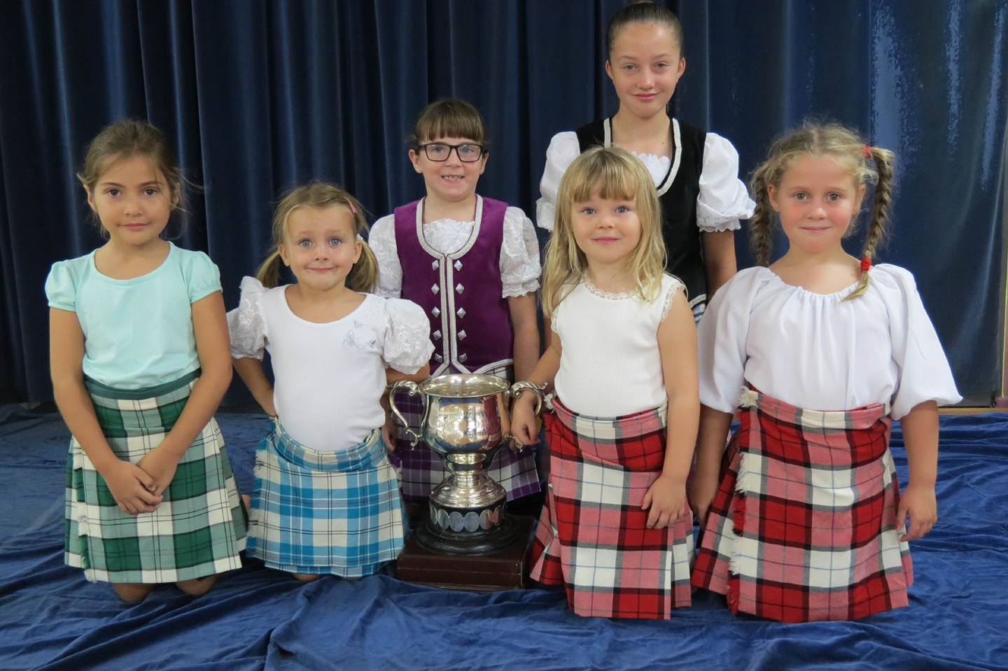 Students from West Coast Highland Dancing School in Greenwood with the 90-year-old Dewar Cup.