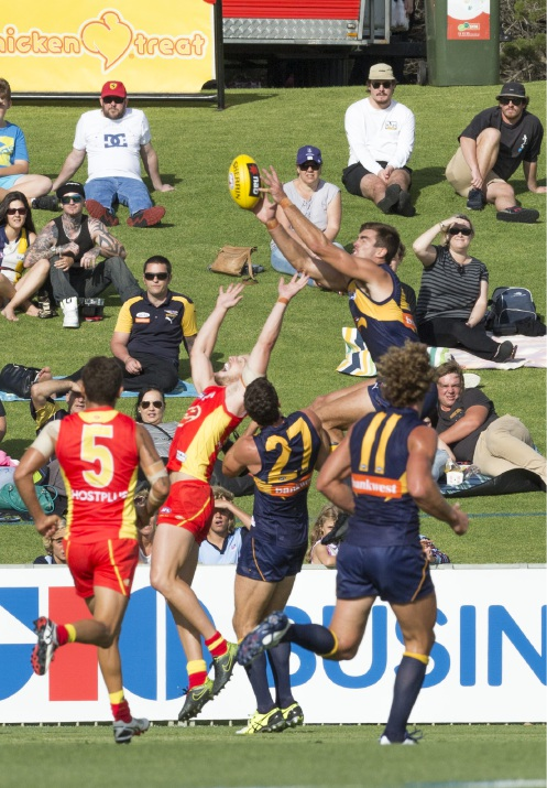 Scott Lycett goes for a grab in front of a modest pre-season crowd at Arena Joondalup. Picture: Dan White