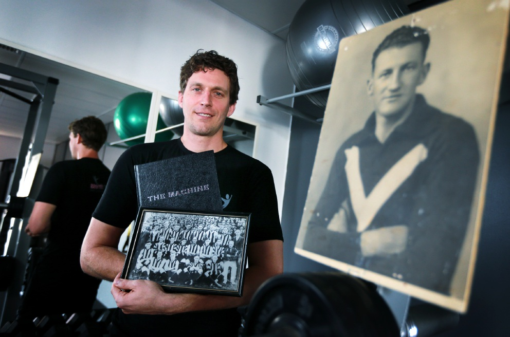Stephen Epis, of High Wycombe, with a picture of his grandfather Frank Murphy who was  inducted into the Collingwood Hall of Fame. Picture: David Baylis www.communitypix.com.au   d451022