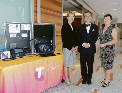 Penny Flett with Canning Mayor Paul Ng and Telstra Business Centre Belmont sales manager Vicki Pearmine. Picture: David Broadway