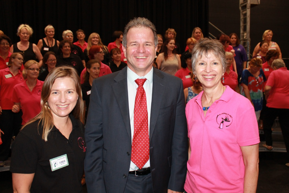 A Cappella West team co-ordinator Linda Wilson, MP Dennis Jensen and A Cappella West member Karin Alt.