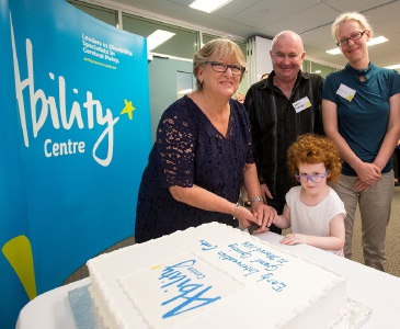 Helen Morton joins Dean and Johanne Eldridge and daughter Joy (4) to open the centre.