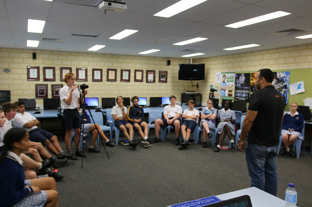 Craig Quartermaine shows Year 10 student Lameze Balea the camera angles. It was lights, camera, action when media video journalist Craig Quartermaine visited Mandurah Baptist College.