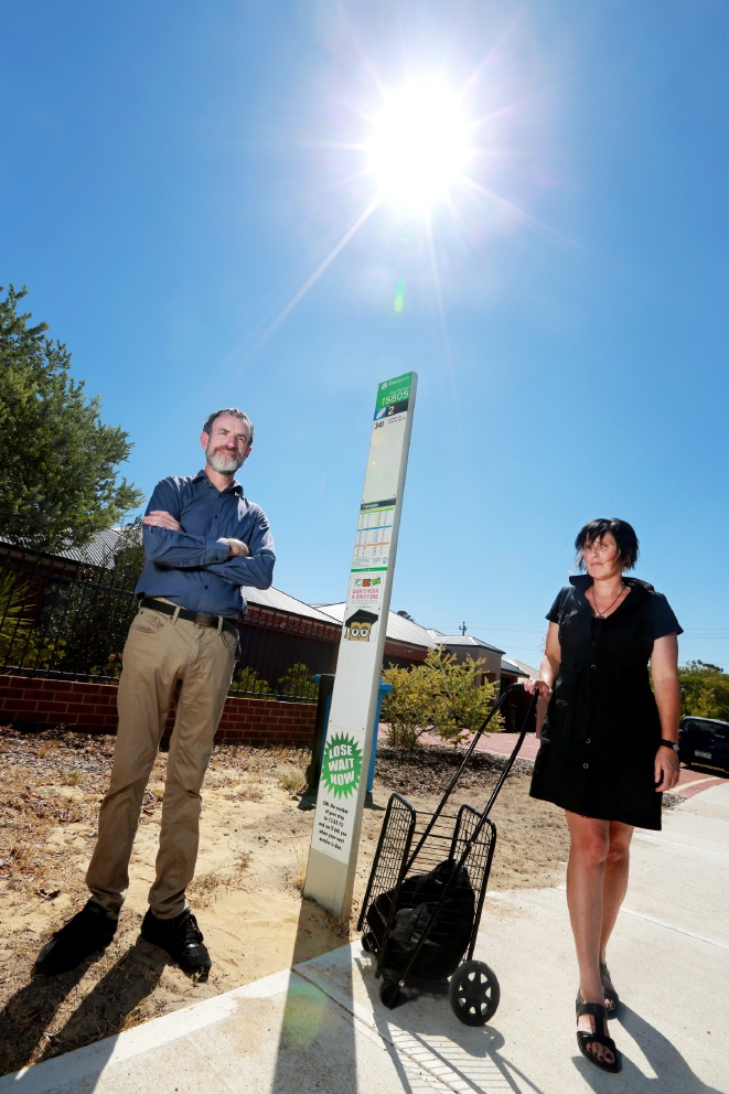 Bassendean residents Grant Lee and Eden Lennox are unhappy a bus shelter in Penzance Street was removed without any notice. Picture: David Baylis d451058
