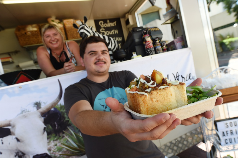 Michelle Krichel and son Skye serving up some South African delights. Picture: Jon Hewson www.communitypix.com.au   d451039 BUNNY chow, bobotie and biltong are among the tasty delights on offer in Perth's first South African food truck.
