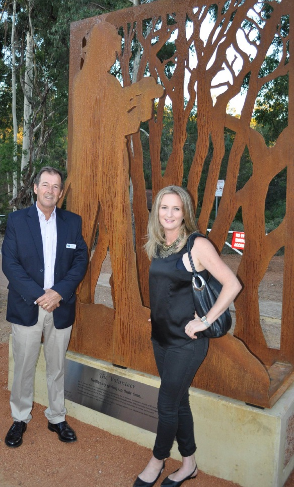 Shire President David Lavell with artist Melinda Brezmen in front of one of the sculptures she created.