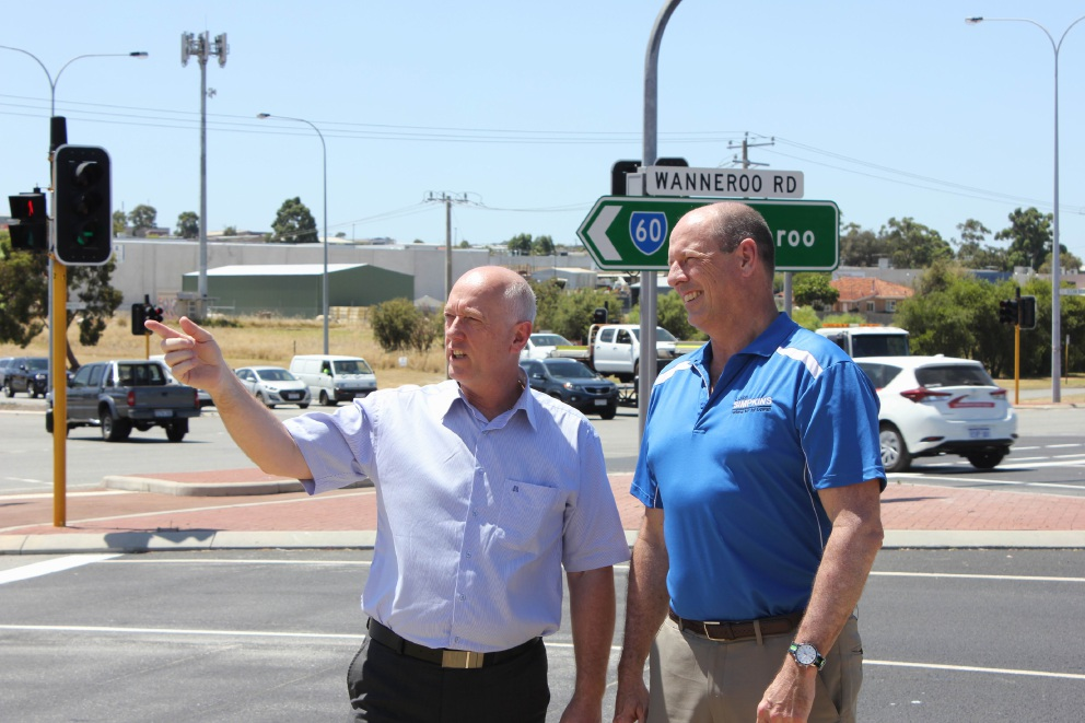 Wanneroo MLA Paul Miles and Cowan MHR Luke Simpkins at the intersection of Wanneroo and Ocean Reef Roads