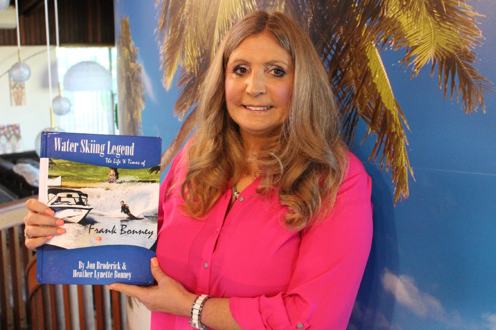 Heather Bonney with the new book she has co-authored about her father, water skiing champion Frank.