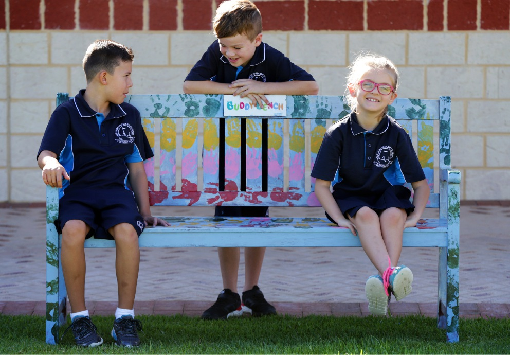 Alkimos PS students Lewis Riddoch, Hendrix Moore and Kayla Robinson at the buddy bench.