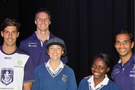 Fremantle Dockers Garrick Ibbotson, Jonathan Griffin and Danyle Pearce with students Madison Dansey and Chido Hove. Garrick Ibbotson (right) discussed social responsibility and community involvement with students and staff. Student Elliot Hanton with Fremantle Dockers ruckman Jonathan Griffin.