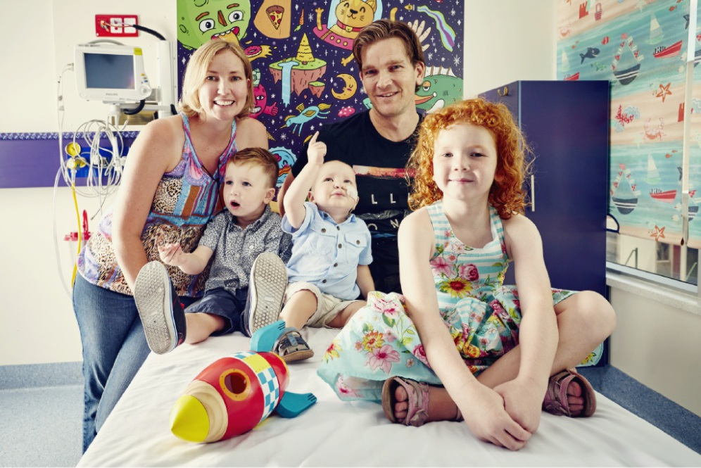 Sweet help: Finlay, Katey, Darren, Harrison and Milla Higgs. Finlay, who was in hospital with cancer, was cheered immensely by the Radio Lollipop team.