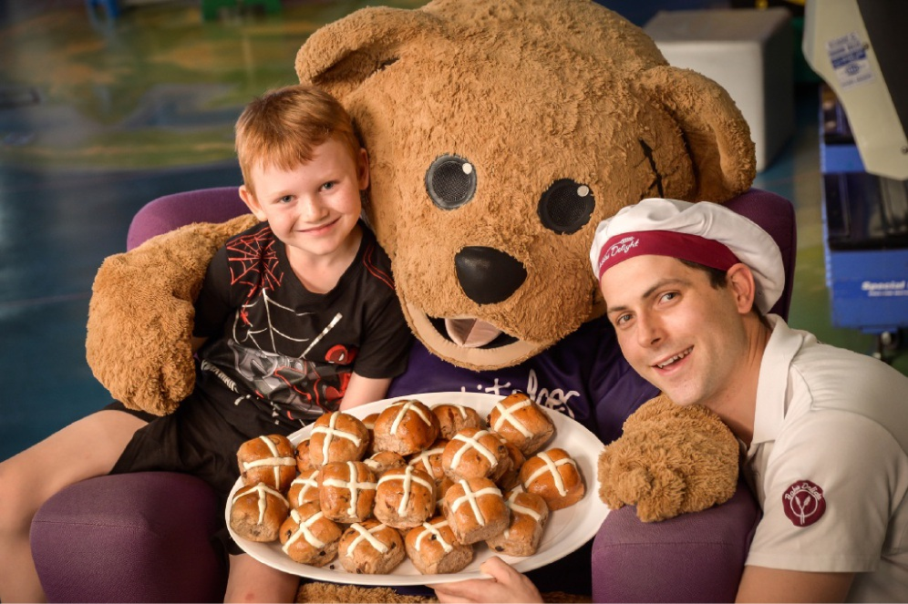 Bundraiser ambassador Logan Craig-Martin with Stitches the Bear and Damon Horne from |Bakers Delight in |Warwick.