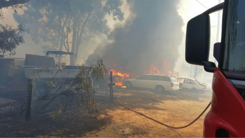 Adrian Zyla took this photograph as firefighters fought to save his Hudman Road property from the Boya fire on Wednesday afternoon.