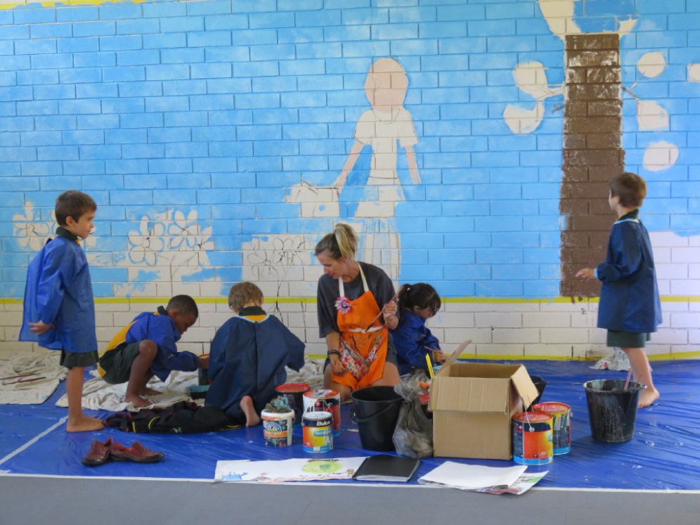 Artist-in-residence Roslyn Nolen works with a group of students on a mural. One of the students' completed murals at Hamersley Primary School.