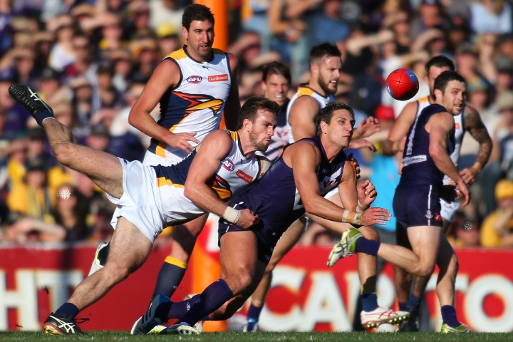 Dean Cox shared the field with Eric Mackenzie many times as a player, now, as a coach, he's happy to see his return from injury. Picture: Getty Images Eagles defender Eric Mackenzie last faced Gold Coast in 2014.