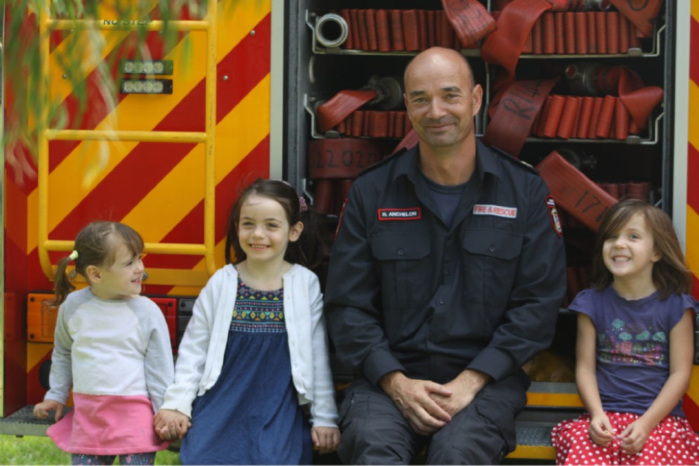 Amelia Pennell, Bronte Luvera and Audrey Grinham with firefighter Hans Anchelon