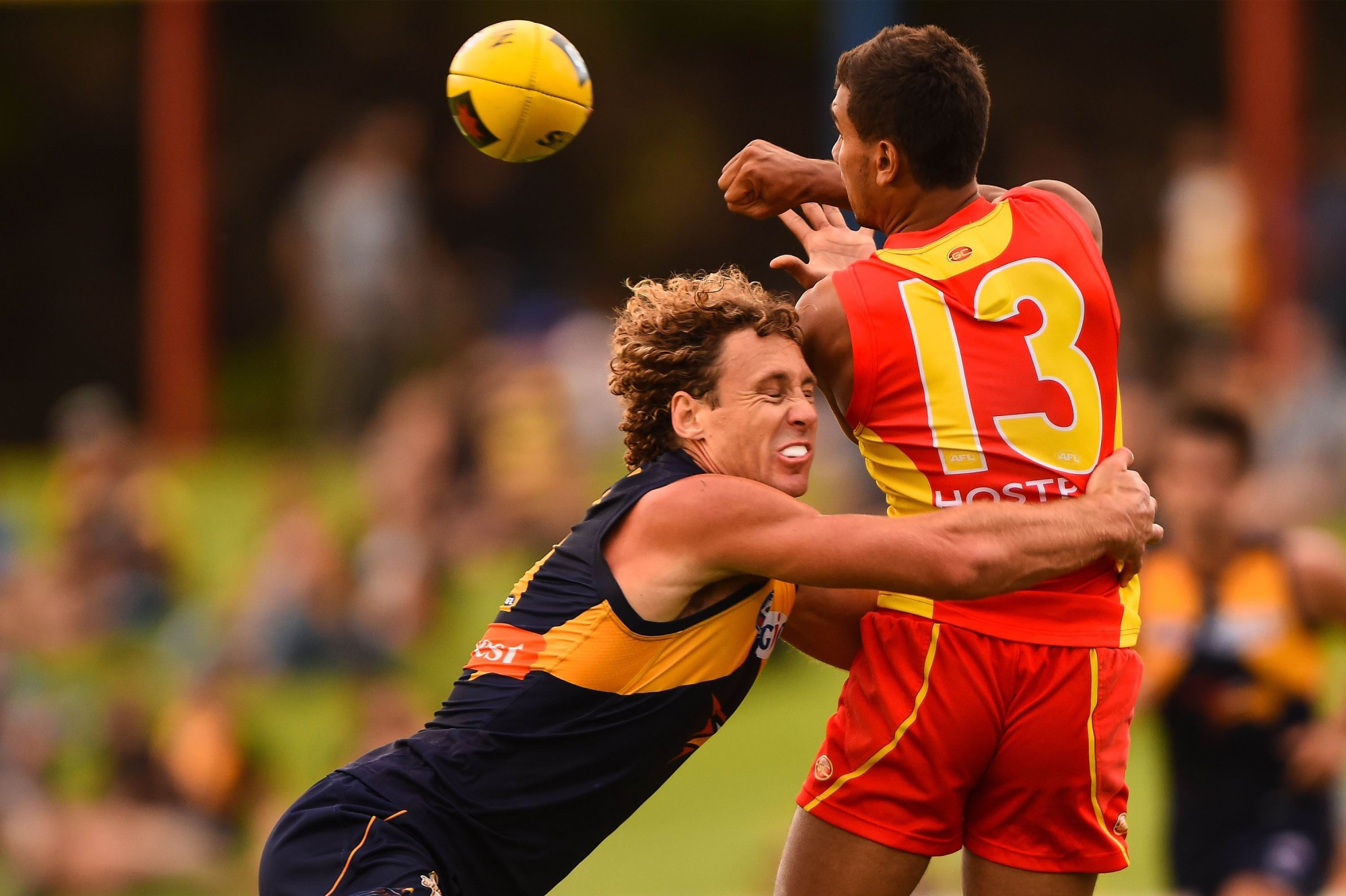 Callum Ah Chee is tackled by West Coast's Matt Priddis.