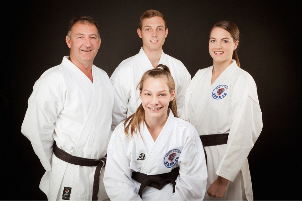 West Coast Karate owner Brian Sullivan with son Michael and daughters Hannah (front) and Rebecca.