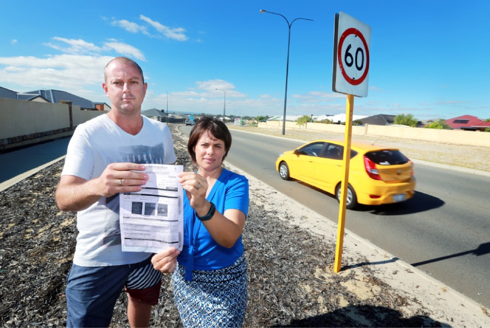 Justin Rob, of Ellenbrook, and local business owner Cilla Fahey-Gilmour with a speeding fine. Picture: David Baylis        d450542