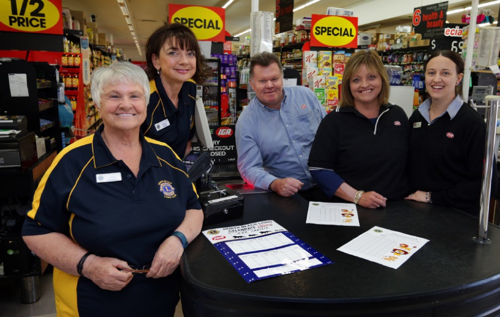 Nicole Napier and Roma Naismith, from North Beach Lions, with store manager Dave Allen and Justine Highway and Carly Tournoff, from Craigie IGA . Picture: Martin Kennealey         www.communitypix.com.au   d450550