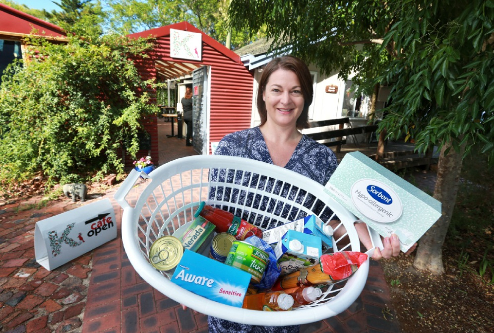 Jo Atkinson outside the Kinfolk Cafe and Flourish Organics where donation items can be left. Picture: David Baylis           d450211