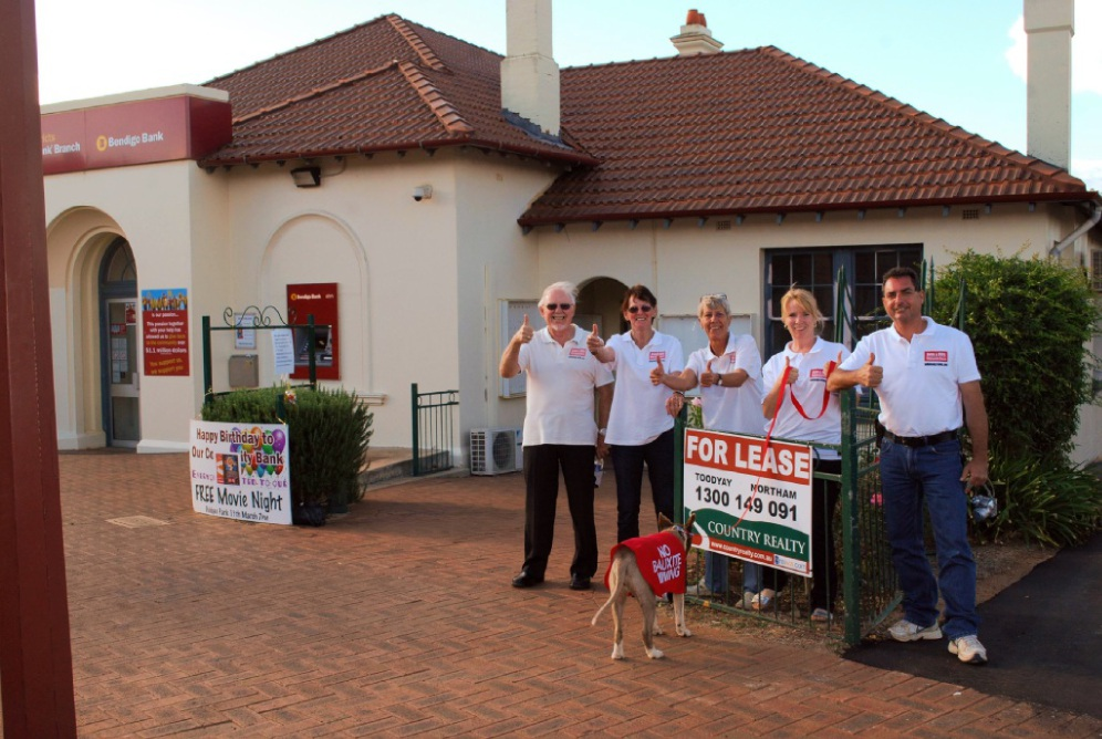 Anti-bauxite mine campaigners David and Hope Jones, Ieva Tomson and Diana and Brian Dale with mascot Brandy in front of the now vacant BAJV office in Toodyay which is up for lease. Picture: Peter Harms