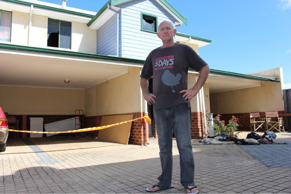 Rob Wilson in front of his neighbour's unit which was gutted inside by the fire. Picture: J Bianchini