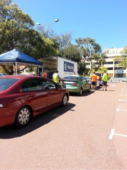 Cars line up to drop off |unwanted clothing at the City of Joondalup's charity collection day.