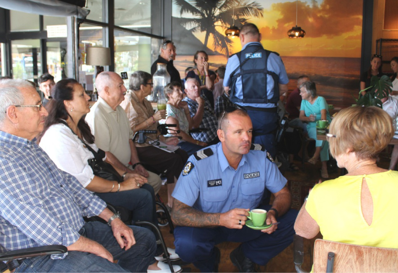 Sergeant Brad Cutler talks to residents at Coffee with a Cop last Friday. Picture: Kate Leaver
