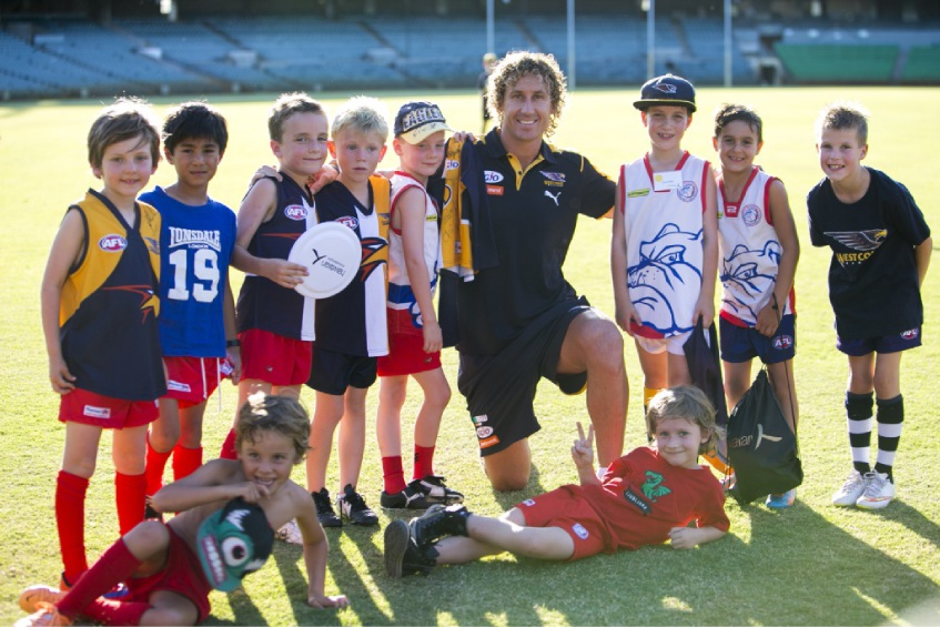 Matt Priddis with a handful of players from the Booragoon Bulldogs Junior Football Club.