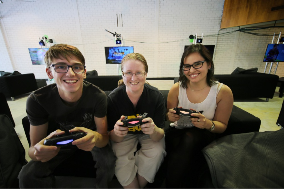 David Woodward, Krystina Atkins and Anita Salamanca at The Glitch gaming centre. Picture: Andrew Ritchie    d450136