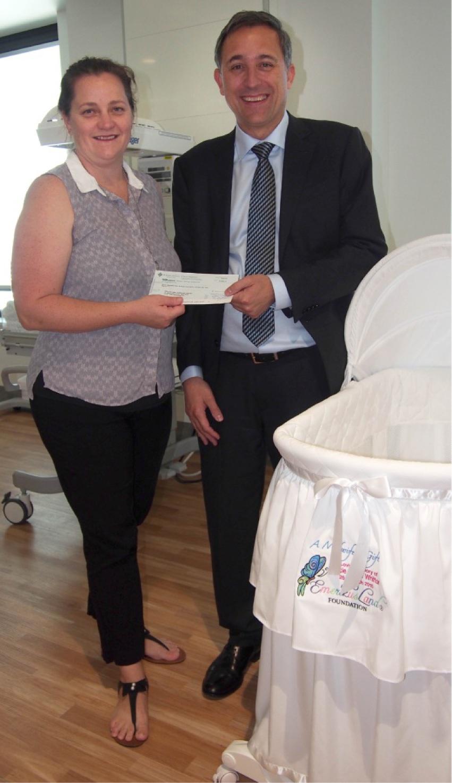 A Midwife's Gift's Kristy Wiegele with St John of God Midland Public Hospital's Glen Power.