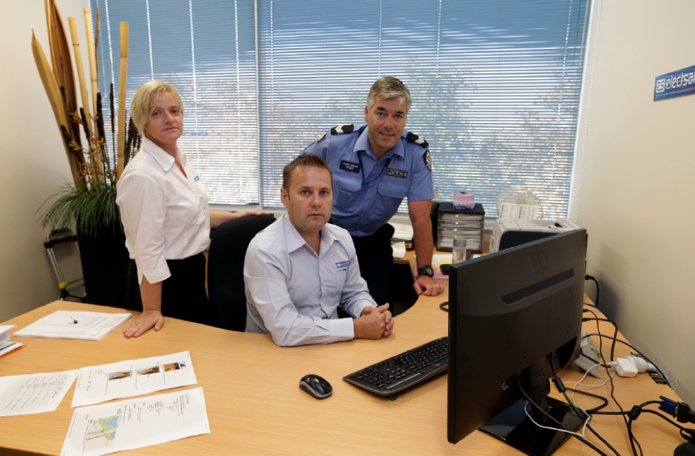 Senior Constable Terry Walsh with Karen Abbasi and Damian Reeve from Electsales. Picture: Martin Kennealey        www.communitypix.com.au d449721