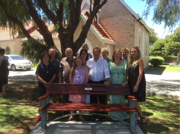 Paramor family members surround one of the benches donated to the church in memory of supporters Don and Katie Paramor.