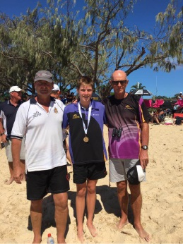 Jack Wilson (14) after his win at the Australian Open Water Championships with father Steve (left) and coach Ralph McManis.