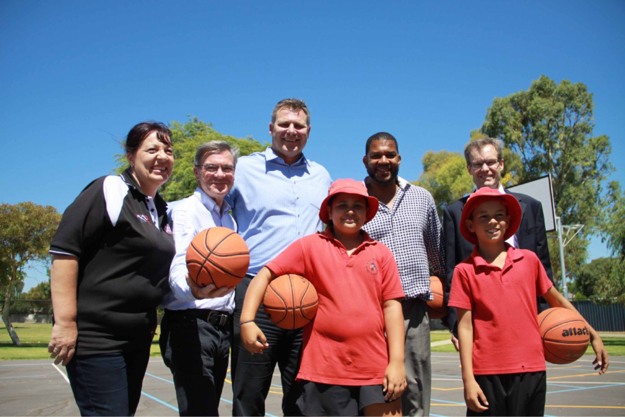 Mineral Resources' Michele Greenwell, Brand MHR Gary Gray, Andrew Vlahov, Ricky Grace and Sam Buckeridge (BGC) with Year 6 students Fern and Robert. Below: Robert tries out the new court.