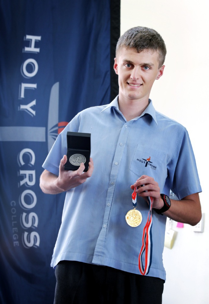 James Evans with his graduation medal. Picture: David Baylis           d449793