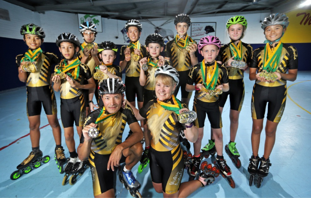 Nick and Irene Myint, of Bassendean, with members of the WA State Speed Skate team. Picture: David Baylis    d449146