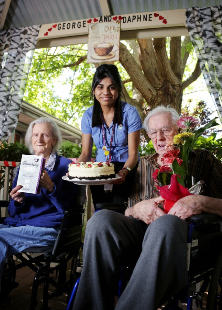 Tuohy aged care home residents Daphne and George Mitchell are presented their cake by clinical nurse manager Mina Pindolia. Picture: David Baylis        www.communitypix.com.au   d449644