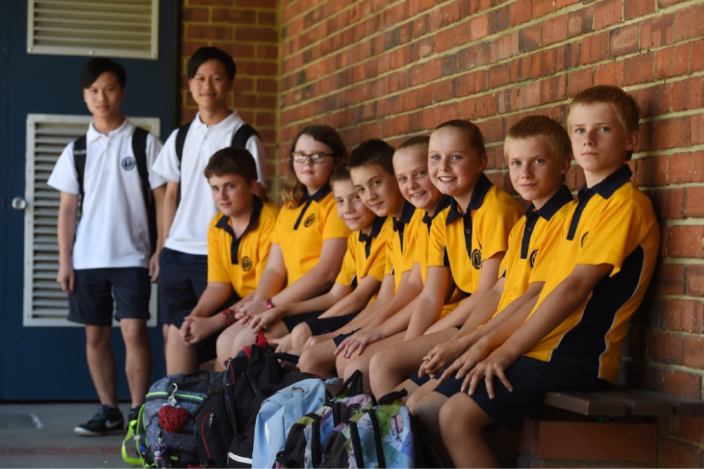 Year 12 twins Daniel and Matthew Foo with new Year 7 twins Darcy and Luke Axford, Emily and Chloe Boothman, Joshua and Jayden Masek and Jasmine and Kyle Beattie.  Picture: Jon Hewson         d449723