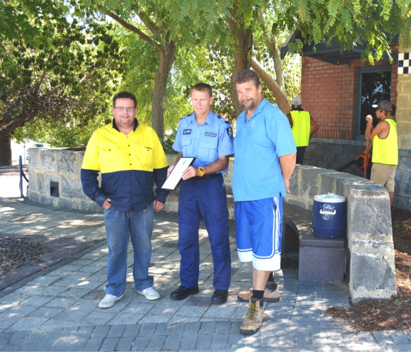 Live Works trainee Tom Edwards and mentor Lee Braithwaite, with Bayswater police officer-in-charge Will Withers (centre), worked with participants at the station. Picture: Toyah Shakespeare