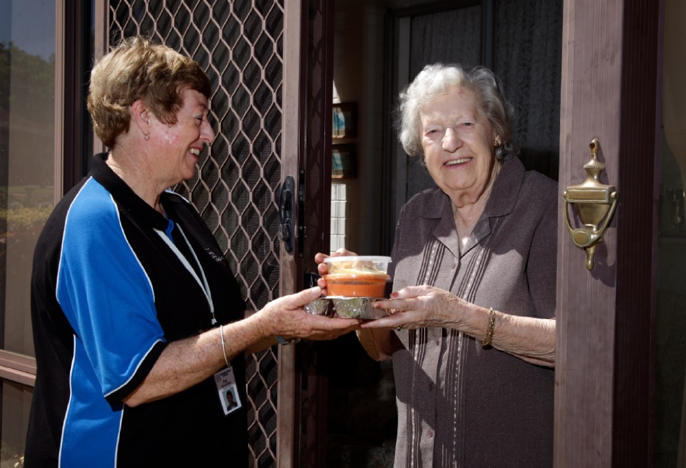 Home Help Delivered Meals volunteer Pat Kellett arrives with a meal for client Betty Watson. Picture: Marie Nirme        www.communitypix.com.au   d449662