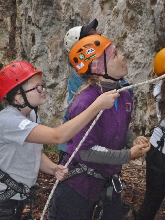 Camp participants enjoy the challenge of abseiling. Camp activities help  foster confidence, self-esteem and teamwork.