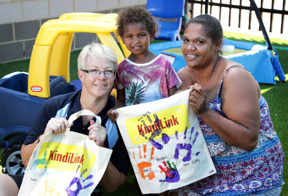 KindiLink teacher Kyra Eddy with Khaleel Kelly (3) and mum Charna Kelly, of Eden Hill. Picture: David Baylis           d449537
